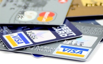 Fees on some payroll debit cards can effectively lower pay below minimum wage. (creative-commons-images.com)