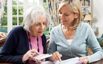 Help is available online for Texans who assist elderly family members or others with financial matters. (Highwaystarz/iStockphoto)
