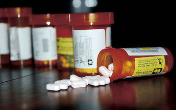 Reining in the cost of prescription drugs is one way to reduce Medicare costs, according to AARP. (USMC/Wikimedia Commons)