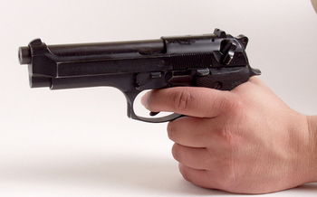 Michigan lawmakers are considering legislation that would allow concealed carry of firearms in public places without a permit. (mconnors/morguefile)