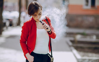People who use them may think e-cigarettes are harmless, but research says they're not. (prostooleh/iStockphoto)