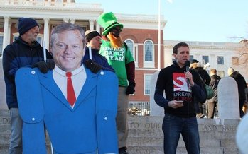 Climate activists used a giant puppet of Gov. Charlie Baker at a