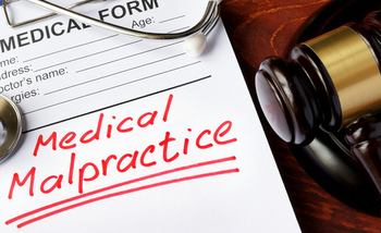 A new poll shows opposition in several primarily Republican states to a bill in Congress that would restrict a patient's ability to sue for malpractice. (designer491/iStockphoto)