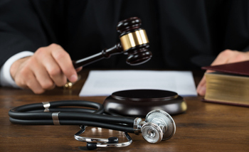 A new poll shows opposition in several primarily Republican states to a bill in Congress that would restrict a patient's ability to sue for malpractice. (AndreyPopov/iStockphoto)