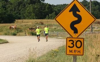 Daren Schumaker and Dennis Lee of Cedar Rapids have spent eight years running marathons in each of Iowa's counties. (Team 99 Counties)