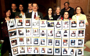 Advocates at the State Capitol displayed a mosaic of New Yorkers who want �people�s commissioners� on the Public Service Commission. (K. Roache)<br />