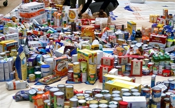 Letter carriers are collecting nonperishable food items this Saturday, May 13, in partnership with local food banks. (Defense.gov/Creative Commons)