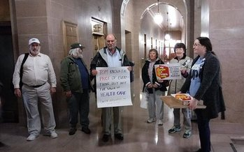 A group of protesters at the West Virginia State Capitol, awaiting the arrival of U.S. Secretary of Health and Human Services Tom Price. (Public News Service-Dan Heyman) (Note: photo was originally misidentified. Heyman took the photo, he was not in it.)