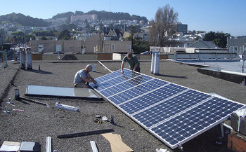 Low-income communities of color largely have been shut out of advances in clean energy technology. (brian kusler/Flickr)