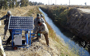 Soldiers in Baghdad install a solar-powered water-filtration system. (U.S. Army/Flickr)