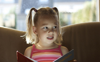 Experts recommend at least 15 minutes of reading a day for younger children during the summer. (George/flickr)