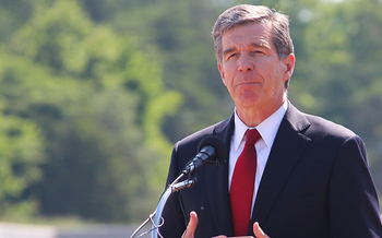 North Carolina Gov. Roy Cooper is now deciding whether to sign the budget passed by the State Assembly. (Cafe Credit/Flickr)