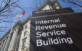 If you get a call from someone identifying themselves as an IRS agent and demanding immediate payment, a Wisconsin consumer expert says hang up, because it's a scam. (Bloomberg/Getty Images)