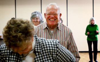Author Doug Griffiths says offering social activities like line dancing for older residents can help revitalize small towns. (Jeffrey Smith/Flickr)