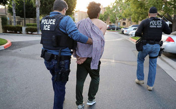 Police and court officers now need more than just an ICE detainer to hold a person in custody, according to a ruling from the state's highest court. (Picssr/Flckr)
