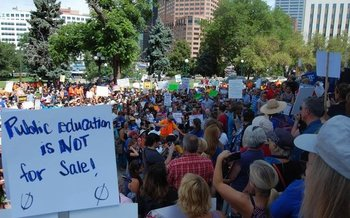 Hundreds gathered at the Colorado State Capitol to protest U.S. Secretary of Education Betsy DeVos' appearance at last week's American Legislative Exchange Council meeting. (Caroline Fry)