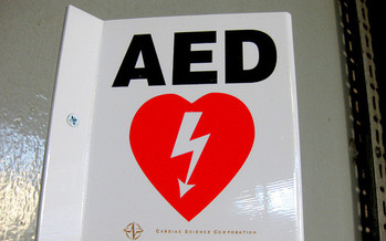 A survey shows half the employees in the United States don't know where the AED is at their workplace, much less how to use it. (Leon Brocard/flickr)
