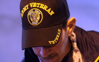 A national survey says 14 percent of American households that rely on food banks include a veteran. In Wisconsin, it's 19 percent. (Justin Sullivan/Getty Images)