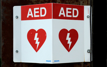 A survey shows half the employees in the United States don't know where the AED is at their workplace, much less how to use it. (Robert Alexander/Getty Images)