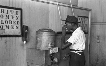 Discrimination may no longer be seen at drinking fountains, but a Des Moines School Board member says it's prevalent in education, health care and the justice system. (WikiImages/Pixabay)