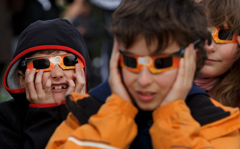 Safety glasses protect the eye from being damaged by looking at the sun. (Getty Images)
