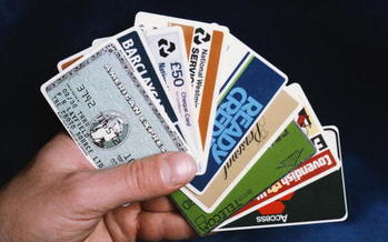 No matter how convincing a caller demanding payment might be, experts say you should never share your credit card number or personal information. (Fox Photo/Getty Images)