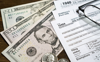 AARP's Tax Aide program helped 2.5 million Americans receive more than $1.3 billion in refunds this year. (Pictures of Money/Flickr)