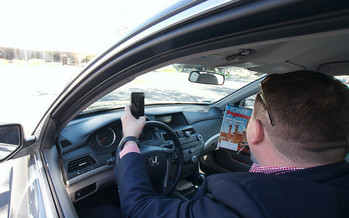 It's illegal in Washington state to use a cellphone while driving. (mliu92/Flickr)
