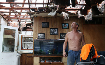 Aaron Tobias inspects what is left of his Rockport home after Hurricane Harvey made landfall Saturday as a Category 4 storm with 130-mph winds. (JoeRaedle/GettyImages)