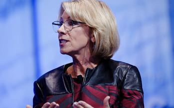 U.S. Education Secretary Betsy DeVos backs a Trump administration budget proposal that would cut total federal spending on public schools by $9 billion. (Michael Vadon/Flickr)
