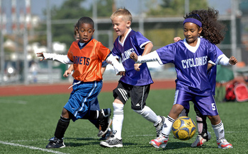 Health experts say kids should be involved in activities such as soccer to fight the growing epidemic of childhood obesity. (Edward N. Johnson/Flickr)