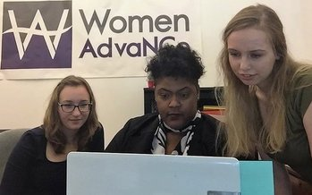 Women AdvaNCe Executive Director Naomi Randolph (center) works with staff members to coordinate the upcoming North Carolina Women's Summit. (Women AdvaNCe)