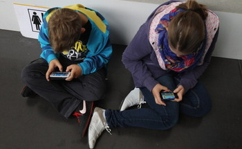 According to one study, mobile media device use has tripled among young children aged 5 to 16 in the past six years. (Getty Images)