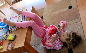 Mobile media device use has tripled among young children aged 5 to 16 in the past six years. (Lars Ploughman/Flickr)