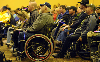 More than 80 percent of those caring for injured veterans are ineligible for Veterans Administration caregiver benefits. (Desiree Palacios/USAF)