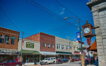 Downtown businesses are flourishing in Mount Airy, thanks to the development of a greenway, because of increased residents, tourists and events. (Allen Forrest/flickr)