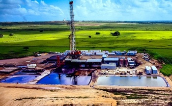 Ponds near oil rigs store wastewater from the fracking process, which is disposed of by injecting it back into the well. Some scientists believe this can cause earthquakes. (GettyImages)