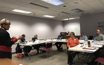 AARP North Dakota fraud fighters hold a training session to help people spot scams. (Doreen Riedman/AARP North Dakota)
