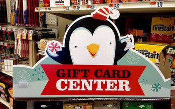 Scammers have been copying numbers from gift cards on kiosks, waiting until they are activated and then draining the funds. (Mike Mozart/Flickr)