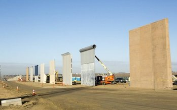 Prototypes of President Trump's proposed border wall were exhibited last October outside San Diego. (texastribune.org)