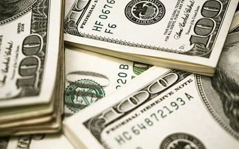 A new billionaire was created every two days last year, according to an Oxfam report. (Pictures of Money/Flickr)