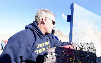 Interior Secretary Ryan Zinke helped clean up a shooting range with Bureau of Land Management workers outside Las Vegas on Thursday. (U.S. Dept. of the Interior)