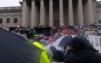 Thousands of teachers and school employees faced a cold rain to rally for better pay and insurance outside the West Virginia Capitol on Saturday. (Dan Heyman)