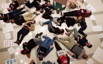 Twenty protesters participate in a Die-In on the fourth-floor rotunda of the Florida State Capitol.  (Lakey Love)