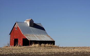 Nebraska lawmakers have competing bills in front of them as they work to bring property-tax relief to land and homeowners. (Dawn in Nebraska/Flickr)