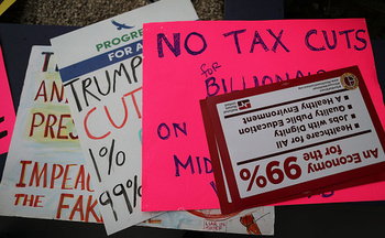 Groups across the country are rallying ahead of tax day to push for a fairer tax structure. (Joe Raedle/Getty Images)
