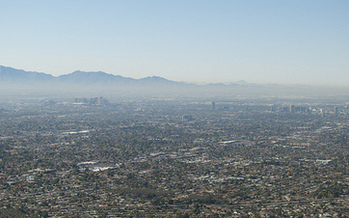 Phoenix's dry, warm climate historically made it a haven for people with respiratory ailments, but now that heat and sunshine are contributing to dangerous smog levels. (Edward Blake/Flickr)