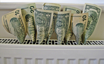 Programs are available that can help low-income Michiganders who are behind on their electric bills. (Images Money/Flickr)