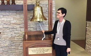 Elizabeth Clarke of Unicoi County rings the victory bell at the Provision CARES Proton Therapy Center – a traditional rite of passage when patients complete their treatment. (Elizabeth Clarke)