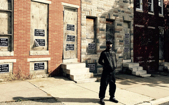 Munir Bahar, 36, founder of COR Health Institute, stands in front of four vacant row homes he reconstructed into a community martial arts and fitness facility dedicated to serving at-risk children living in East Baltimore. (COR Health Institute)